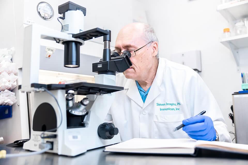 Dr. Steve looking in microscope